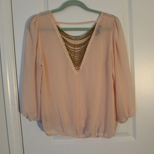 Blouse with gold accessories